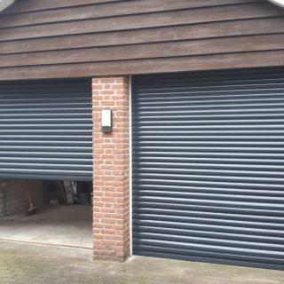 garagedeuren Rolpoort rolluik antraciet grijs Frema zonwering rolluiken rolluik garagedeur Rhenen Ede Veenendaal Utrecht Gelderland Betuwe eo