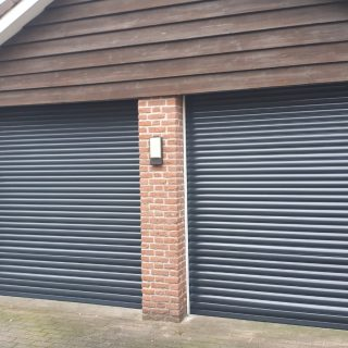 garagedeuren rolpoort rolluiken garagedeuren antraciet grijs Frema zonwering Rhenen Veenendaal Ede Wageningen Utrecht Gelderland Betuwe eo
